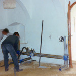 Mechanical cutting of walls in order to create a barrier for rising damp.